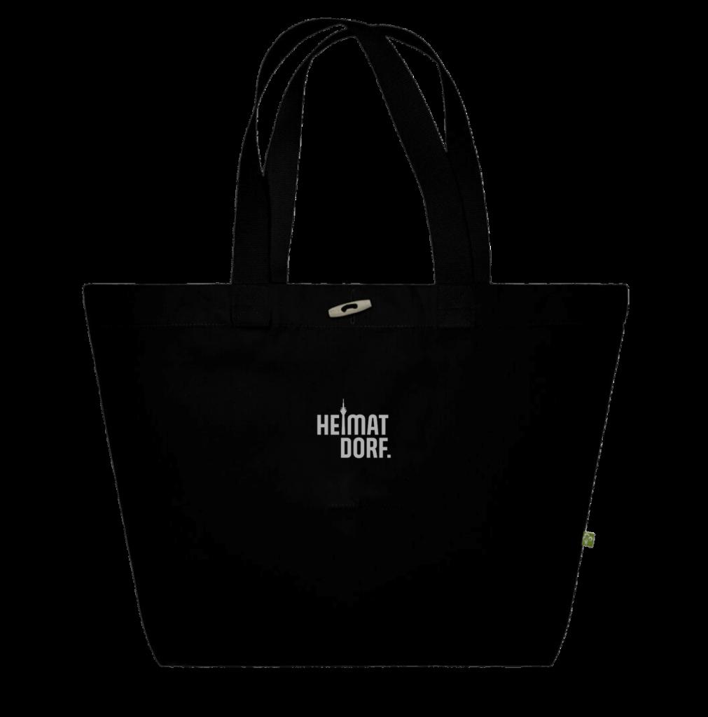 Schwarze Tasche aus Biobaumwolle mit reflektierendem Düsseldorf HeimatDorf Logo