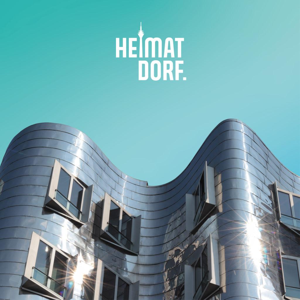 Silbernes, freigestelltes Ghery-Haus auf türkisem Hintergrund mit weißem Düsseldorf HeimatDorf-Logo bedruckt