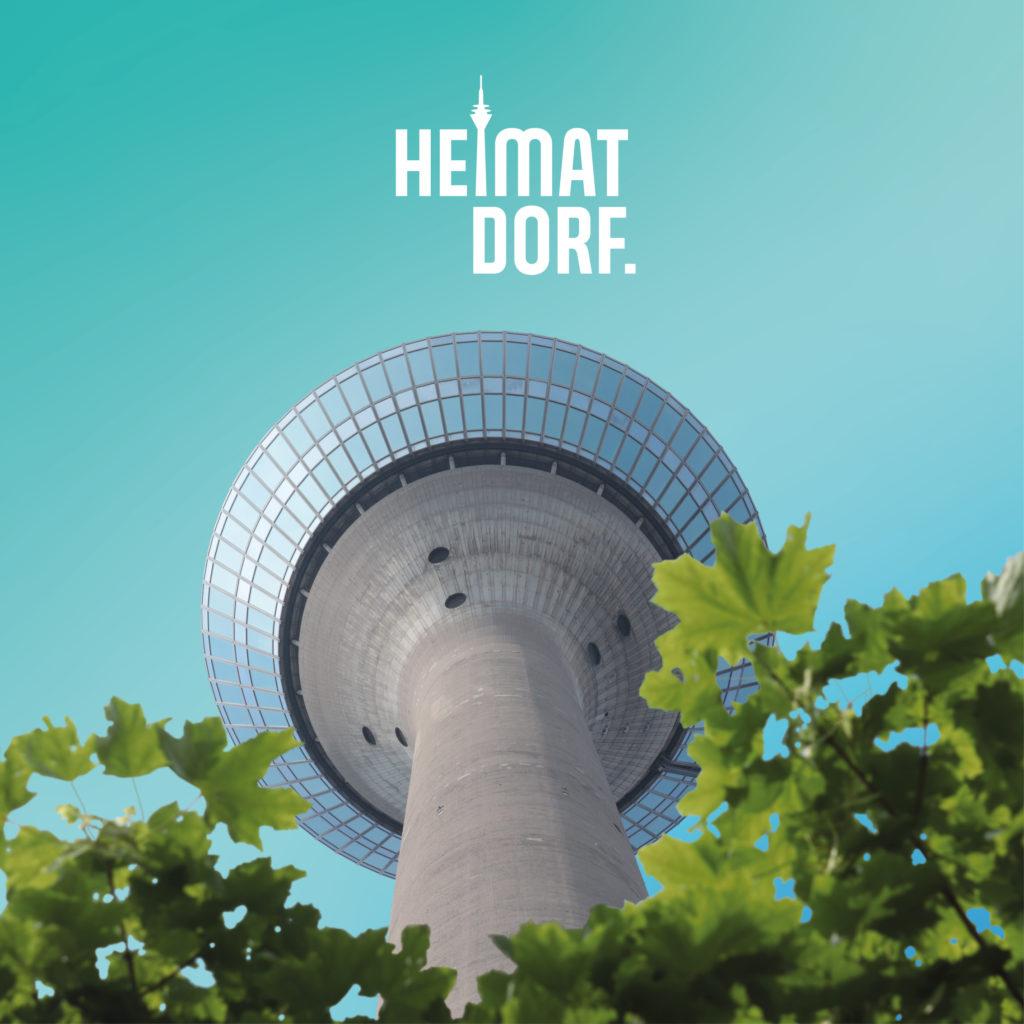 Rheinturm Düsseldorf von unten nach oben fotografiert. Im Vordergrund sind Blätter. Das Motiv ist auf Türkise Hintergrund gedruckt und mit dem weißen Düsseldorf HeimatDorf-Logo bedruckt.