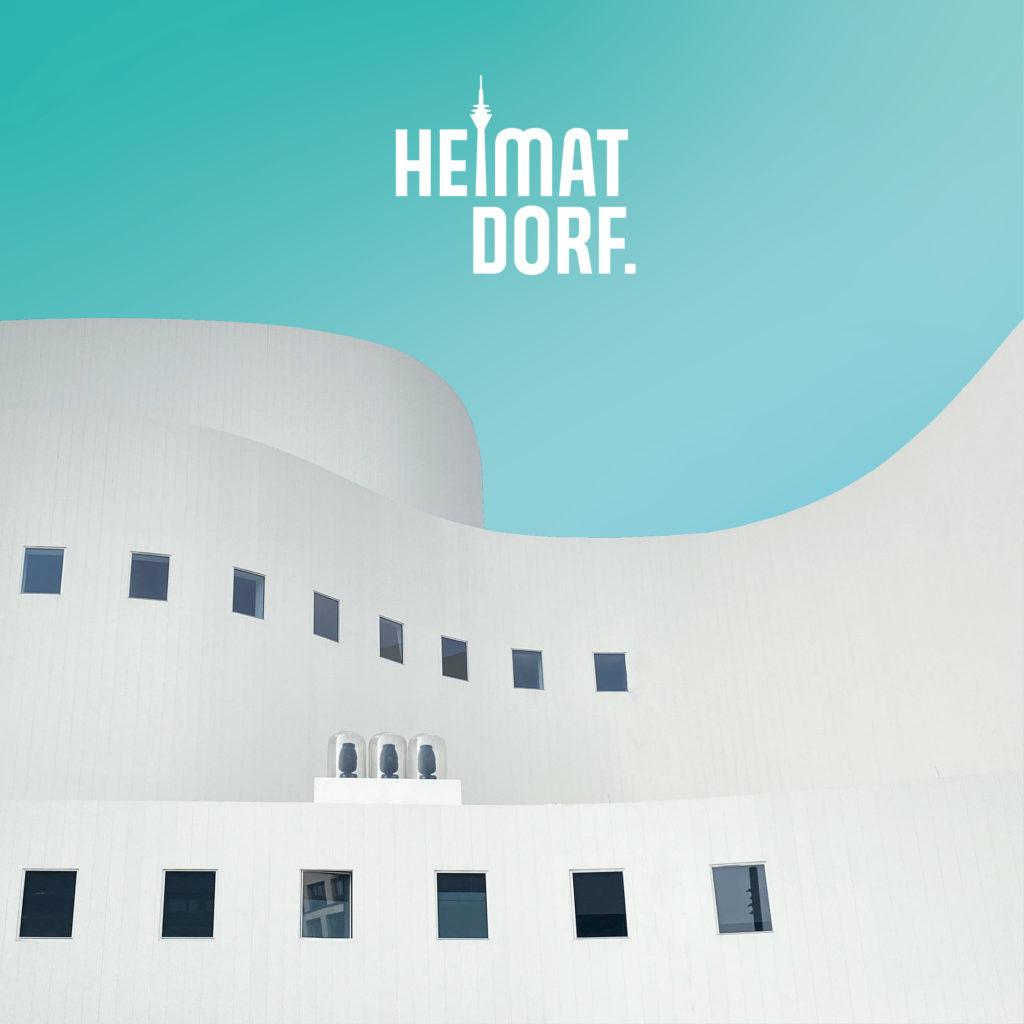 Ausschnitt des Düsseldorfer Schauspielhaus auf türkisfarbenem Hintergrund mit weißem Düsseldorf HeimatDorf-Logo darauf